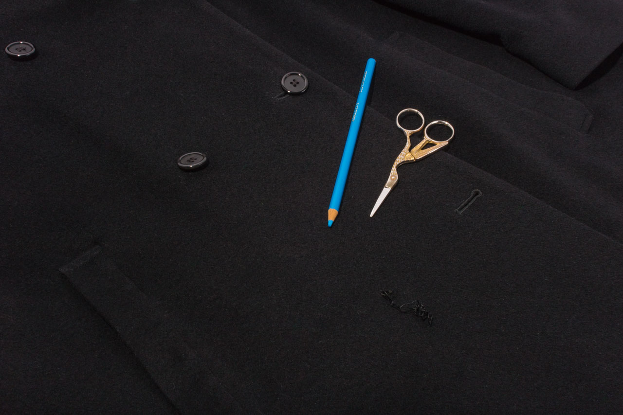 Assembil Blog: Repair Coat Buttons. Mark position of missing button.