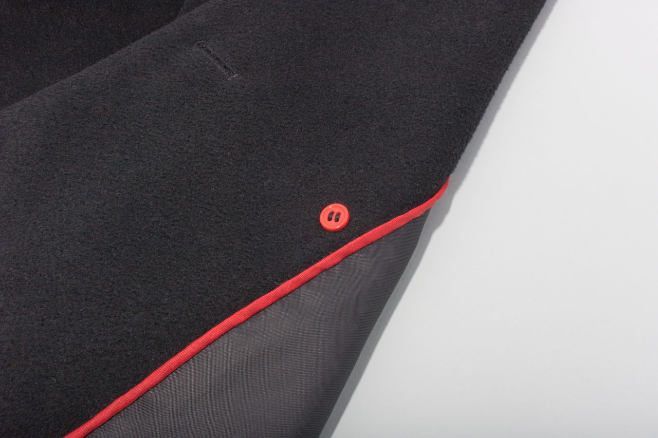 Assembil Blog: Repair Coat Buttons. Finished backing button on inside of coat.