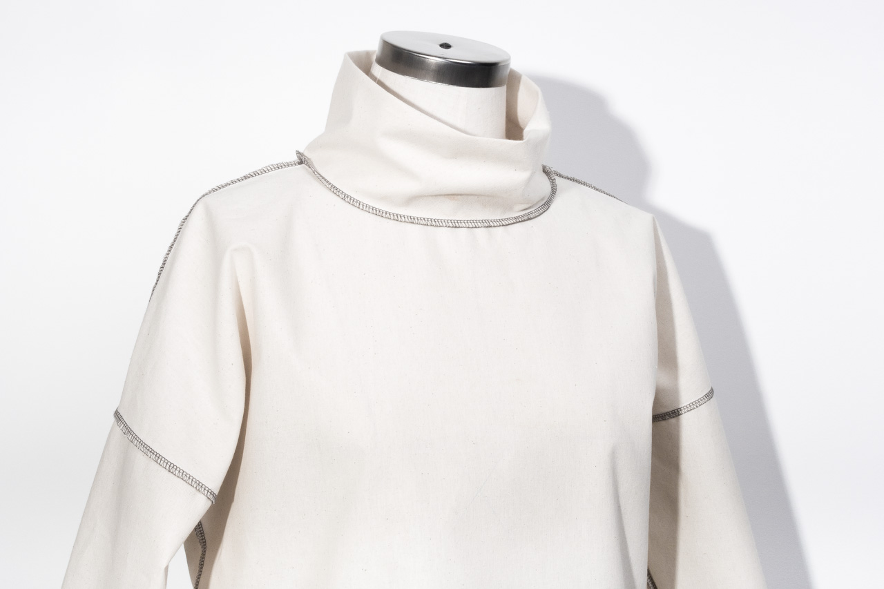 Assembil Blog: The Paper Theory LB Pullover pattern. Toile front detail of overlocking and neckband.